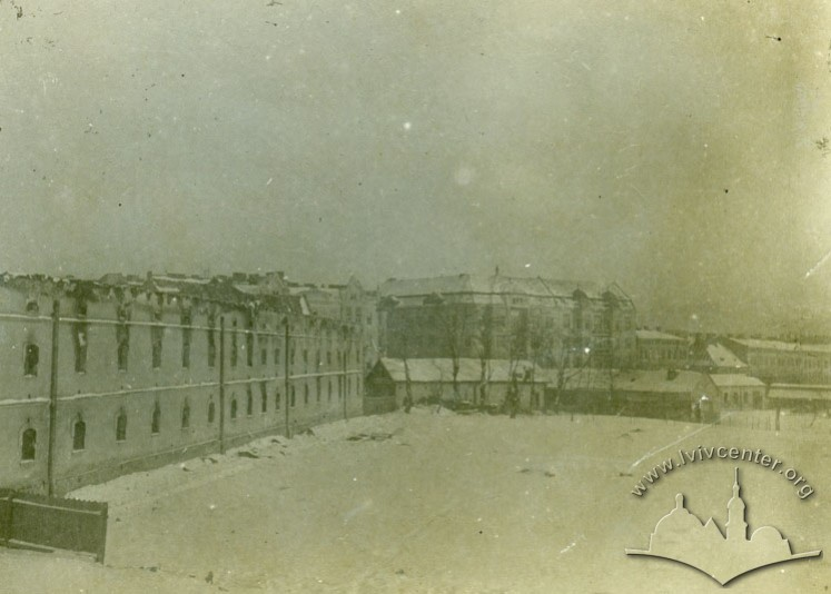 Destroyed barracks. On the background, the residential buildings on Janowska street (today Shevchenka)